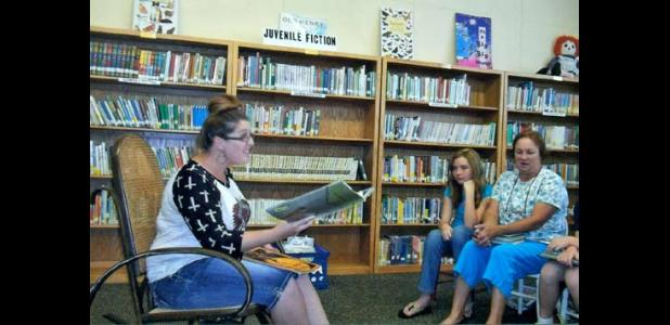 Shelby Rinehart, 'Reader' Library Summer Reading Program, and also Alyx Black, First Prize winner and Janey Morgan also a reader.