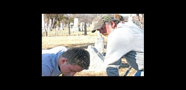 Conner Johnson (left) working at Eastland City Cemetery with his father Kevin Johnson assisting.