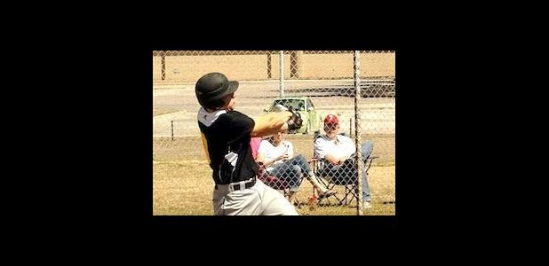 Kaleb Rains (9) swings for the fence against Comanche