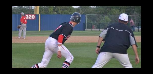J.D. Coffee looks to tag on the fly ball with Coach Hatton eyeing the ball.