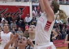Kaylin Brown (5) hits an open lay up in the 1st quarter against the Lady Loboes.