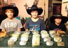 from left to right are Bailey Barrett (13), Jade Barrett (12), and Trace Barrett (7), the children of Will and Pepper Barrett of Ranger Texas.